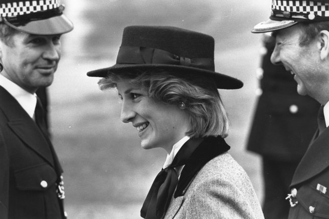 Two police officers admire the Princess of Wales on March 29, 1984, during her visit to the Metropolitan Police Training Establishment in Hendon, England. UPI File Photo