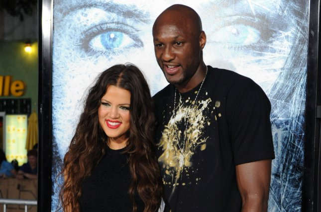 Khloe Kardashian (L) and Lamar Odom at the Los Angeles premiere of Whiteout on September 9, 2009. File Photo by Jim Ruymen/UPI