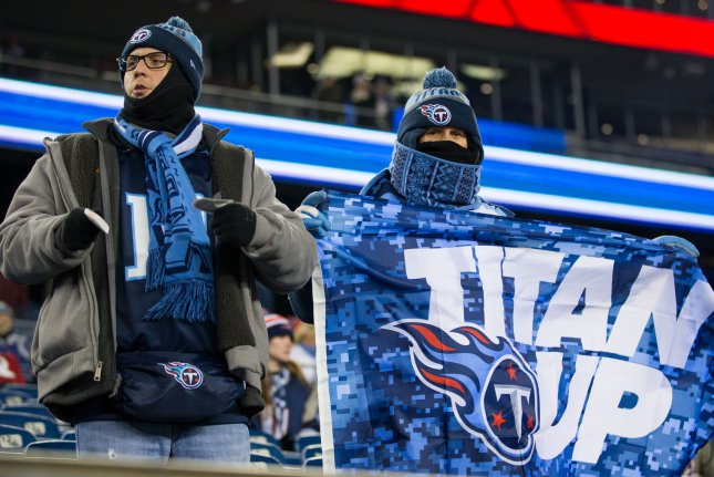 Tennessee Titans fans await for the arrival of their team prior to the AFC Divisional round playoff game against the New England Patriots on January 13 at Gillette Stadium in Foxborough, Mass. Photo by Matthew Healey/UPI