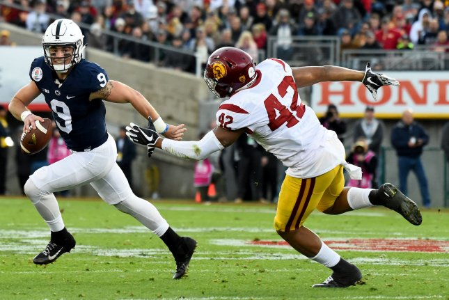 Penn State Nittany Lions quarterback Trace McSorley (9) scrambles to avoid the tackle of USC Trojans defender Uchenna Nwosu (42) during the 2017 Rose Bowl on January 2, 2017 in Pasadena, California. Photo by Juan Ocampo/UPI