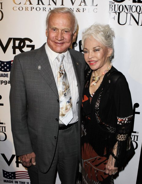 Buzz Aldrin and Lois Driggs arrive at the 25th Great Sports Legends Dinner to benefit the Buoniconti Fund to Cure Paralysis at the Waldorf Astoria in New York City on September 27, 2010. UPI/John Angelillo