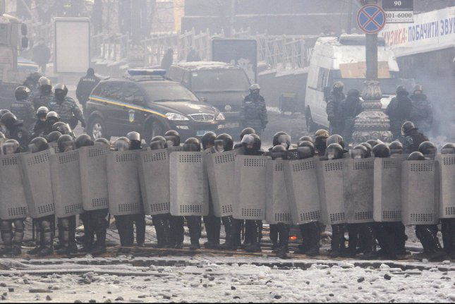Ukrainian riot police stand near a barricade operated by anti-government protesters at the site of clashes with riot police in Kiev on January 25, 2014. Ukrainian President Viktor Yanukovich promises changes after violent clashes. UPI/Ivan Vakolenko
