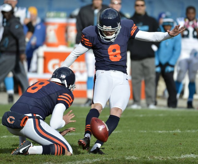 Chicago Bears kicker Robbie Gould kicks the game-winning field goal as Adam Podlesh holds the football as time expires in the fourth quarter against the Carolina Panthers at Soldier Field on October 28, 2012 in Chicago. The Bears won 23-22. UPI/Brian Kersey