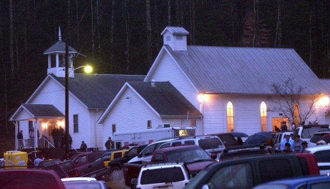 Family members and town residents gather in the Sago Baptist Church as they wait to hear of the news on the 13 trapped miners, in Tallmansville, WV, on January 3, 2006. Thirteen coal miners became trapped after an explosion sealed of a coal mine in Tallmansvillem, WV.. (UPI Photo/Kevin Dietsch)