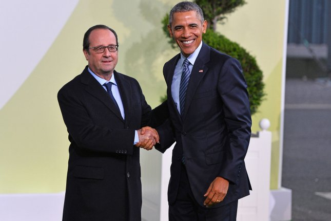 U.S. President Barack Obama, right, is greeted by French President Francois Hollande on Monday at the United Nation's 21st climate change conference at Le Bourget near Paris. The almost 150 heads of state and representatives from nearly 200 countries in attendance will attempt to negotiate a legally binding agreement to limit worldwide carbon emissions with the goal of keeping global warming under 2 degrees Celsius. Photo by David Silpa/UPI
