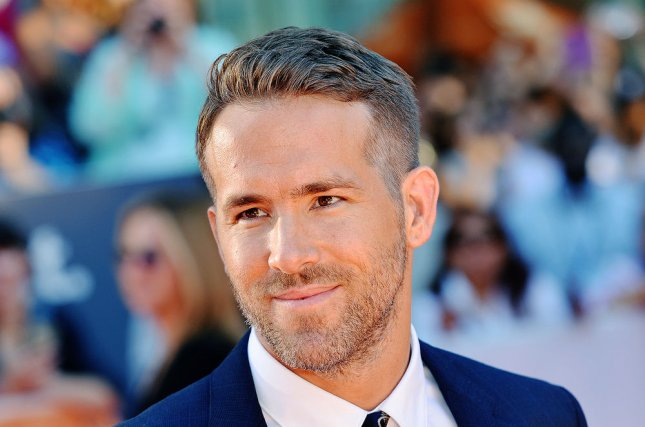 Deadpool star Ryan Reynolds arrives at the Canadian premiere of Mississippi Grind on September 16, 2015. Deadpool producer Simon Kinberg and director Tim Miller have dicussed their eagerness for a Deadpool crossover with Sony and Marvel's Spider-Man. File Photo by Christine Chew/UPI