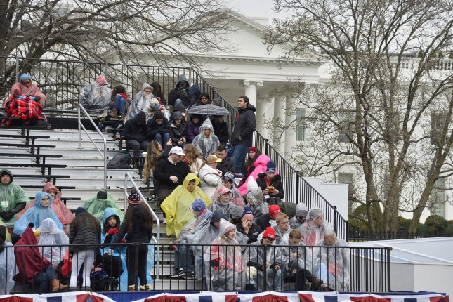 Spectators are framed by the White House before the presidential inaugural parade for Donald J. Trump on Pennsylvania Avenue on Friday in Washington, D.C. Photo by David Tulis/UPI