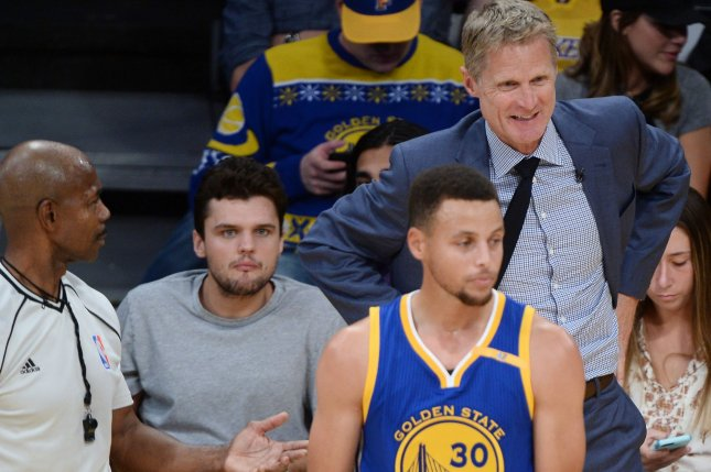 122cd558a910 Golden State Warriors point guard Stephen Curry (R) argues the call as head  coach Steve Kerr chimes in during a game against the Los Angeles Lakers at  ...