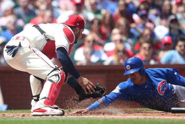 St. Louis Cardinals catcher Yadier Molina puts a late tag on Chicago Cubs' Addison Russell allowing him to score in the second inning on May 5 at Busch Stadium in St. Louis. Photo by Bill Greenblatt/UPI