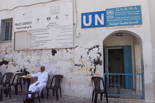 A Palestinian refugee sits outside a UNRWA office in the Deheishe refugee camp in Bethlehem, West Bank, on Thursday. Photo by Debbie Hill/UPI