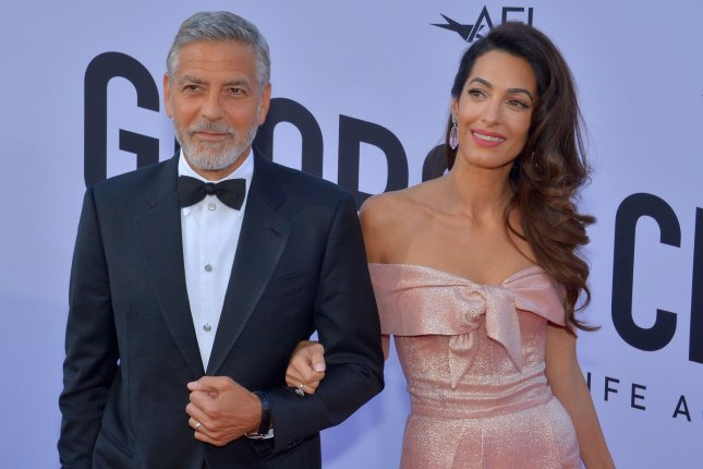 George Clooney (L), pictured with Amal Clooney, recalled his time on ER ahead of his return to television. File Photo by Jim Ruymen/UPI