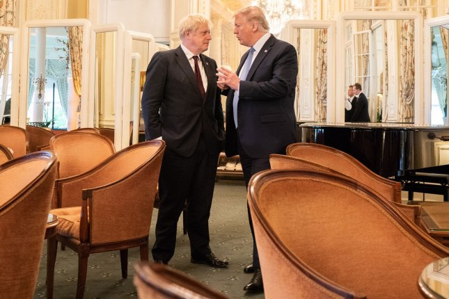 U.S. President Donald Trump and British Prime Minister Boris Johnson speak at the Hotel du Palais Biarritz in Biarritz, France, during the G7 Summit on August 25. File Photo by Shealah Craighead/White House