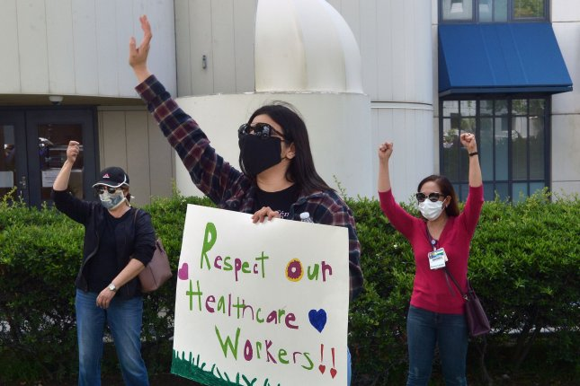 Employees picket outside the Providence St. Joseph Medical Center in Burbank, Calif., on May 19. Front-line COVID-19 workers told President-elect Joe Biden Wednesday they need better protections and resources to fight the pandemic. File Photo by Jim Ruymen/UPI