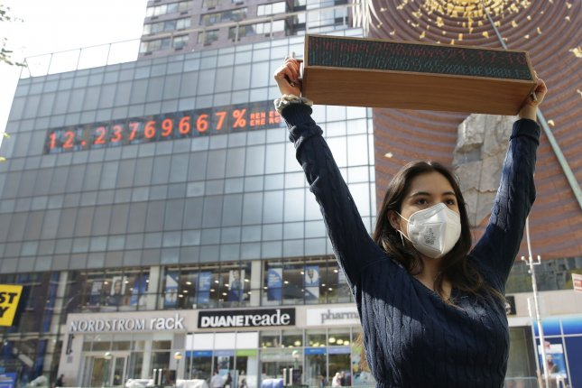 Climate striker Xiye Bastida holds a Climate Clock during an event in New York City on Monday to showcase climate justice solutions and demand bolder, quicker action by the Biden administration ahead of the president's climate summit on Thursday. Photo by John Angelillo/UPI