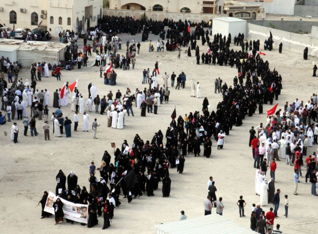 Bahraini anti-government protesters demonstrate in Manama, Bahrain on March 18, 2011 . Thousands of Bahrainis gathered for the funeral of the demonstrator slain hours after the king declared martial law in response to a month of escalating protests. Shiites account for 70 percent of the tiny island's half-million people but they are widely excluded from high-level posts and positions in the police and military. UPI\Isa Ebrahim