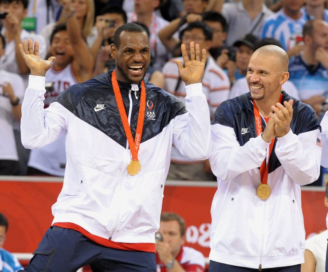 USA's Lebron James dances (L) as USA's Jason Kidd applauds after receiving their medals for the win over Spain to claim the gold medal for Men's Basketball during the 2008 Summer Olympics in Beijing on August 24, 2008. The US won 118 to 107. (UPI Photo/Roger L. Wollenberg)