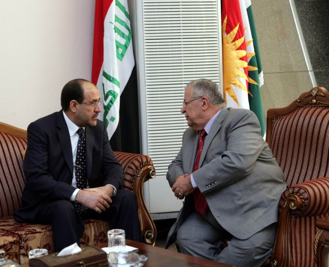 Iraq's President Jalal Talabani (R) talks with Iraq's Prime Minister Nouri al-Maliki during his visit to Iraq's autonomous Kurdistan region near Sulaimaniya, 260 km (160 miles) northeast of Baghdad, August 2, 2009. Al-Maliki met Kurdish President Masoud Barzani on Sunday, the first meeting between the two rivals in many months, in an effort to resolve a row that threatens fresh conflict in Iraq. UPI/Iraq PM Office