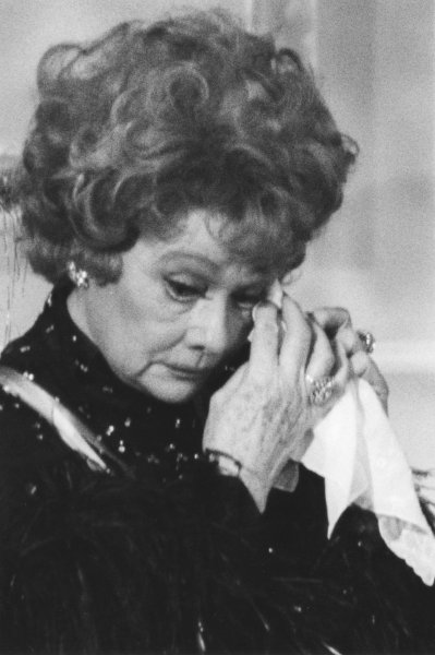 An emotional Lucille Ball reacts tearfully to a poignant salute to her and her longtime husband-collaborator, Desi Arnaz, by President Ronald Reagan on December 7, 1986 during a ceremony in the East Room of the White House in Washington for the Kennedy Center honorees. (UPI Photo/Vince Mannino/Files)