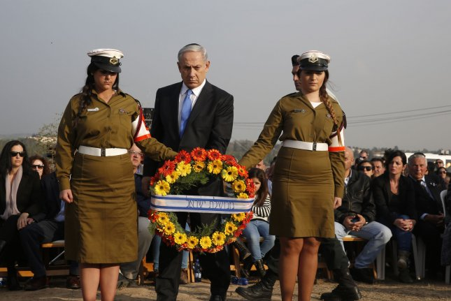 Israeli Prime Minister Benjamin Netanyahu places a wreath during the funeral of Ariel Sharon near Sycamore Farm, the former PM's residence in southern Israel, Jan. 13, 2014. Sharon died Jan. 11, 2014, at the age of 85. UPI/Baz Ratner/Pool