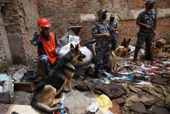Rescue teams with rescue dogs search for the victims in the collapsed buildings after the earthquake in Kathmandu, Nepal on May 1, 2015. Seven days after the quake, the UN said the tremor killed thousands and affected eight million people, which is more than 25 percent of the Nepal population. More than 1.5 million are in need of food assistance. Photo by Sanjog Manandhar/UPI.