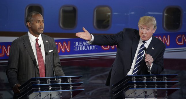 Republican presidential candidates Dr. Ben Carson (L) and businessman Donald Trump square off during the second Republican presidential debate at the Reagan Library in Simi Valley, California on September 16, 2015. In a dead heat in polls, Trump now likens Carson to a child molester. Photo by Max Whittaker/UPI/Pool