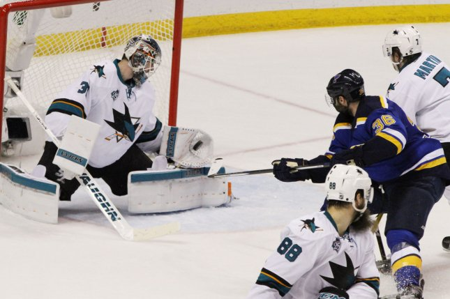 San Jose Sharks goaltender Martin Jones stops the puck after a shot from St. Louis Blues' Troy Brouwer. Photo by Robert Cornforth/UPI
