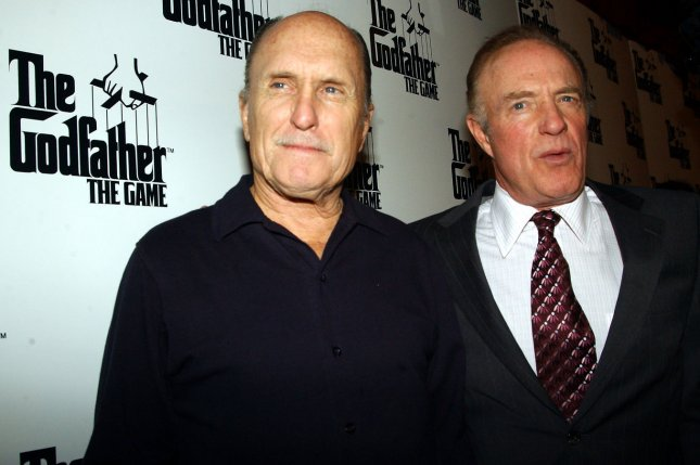 Actors Robert Duvall and James Caan (right) who starred in the first Godfather movie, appear at a Feb. 2, 2005 promotional event in New York for EA Games, which produced a Godfather video game. The pair will reunite with their Godfather co-stars at the Tribeca Film Festival next month. File Photo by Ezio Petersen/UPI