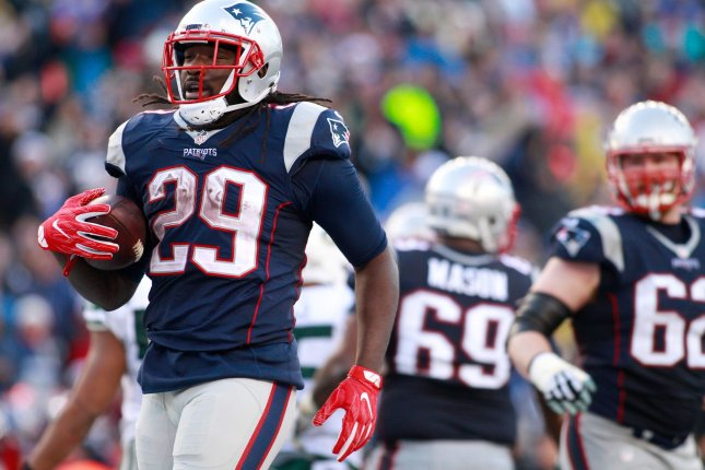 New England Patriots running back LeGarrette Blount (29) walks into the end zone after scoring on a one-yard touchdown in the third quarter against the New York Jets at Gillette Stadium on Dec. 24 in Foxborough, Mass. File photo by Matthew Healey/ UPI