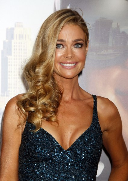 Denise Richards got engaged to Aaron Phypers after about a year of dating. File Photo by Laura Cavanaugh/UPI