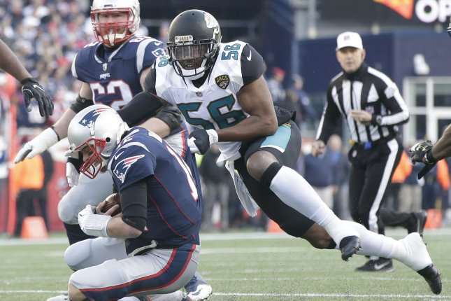 Jacksonville Jaguars defensive end Dante Fowler Jr. (56) sacks New England Patriots quarterback Tom Brady for a 3-yard loss in the second quarter of the AFC Championship Game on January 21, 2018 at Gillette Stadium in Foxborough, Massachusetts. Photo by John Angelillo/UPI