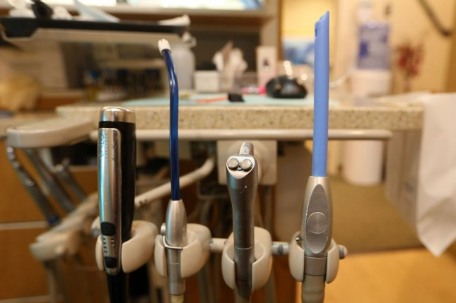 Dental tools can easily aerosolize saliva, but new research suggests the addition of a food-grade polymer can prevent water droplets from becoming airborne. Photo by Bill Greenblatt/UPI