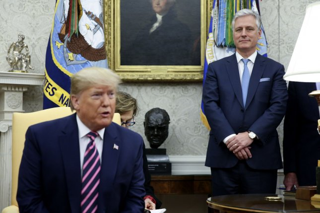 National security adviser Robert O'Brien (R) listens as President Donald Trump speaks in the Oval Office of the White House on December 19, 2019. File Photo by Oliver Contreras/UPI