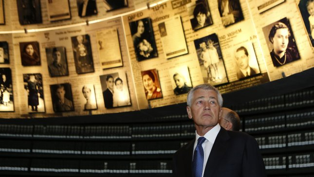 U.S. Secretary of Defense Chuck Hagel looks at pictures of Jews killed in the Holocaust during a visit to the Hall of Names at Yad Vashem's Holocaust History Museum in Jerusalem April 21, 2013. Hagel said on Sunday a $10 billion arms deal planned with Arab and Israeli allies sent a very clear signal to Iran that military options remain on the table over its nuclear program. UPI/Baz Ratner/Pool