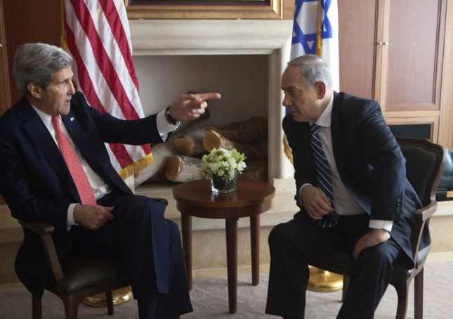 United States Secretary of State John Kerry (left) talks with Israeli Prime Minister Benjamin Netanyahu during a breakfast meeting in Jerusalem, Israel on November 6, 2013. Kerry said that the United States would continue to support Israel and work towards a peace agreement with the Palestinians. Kerry will also meet later in the day with Palestinian Authority president Mahmoud Abbas. UPI/Heidi Levine/Pool