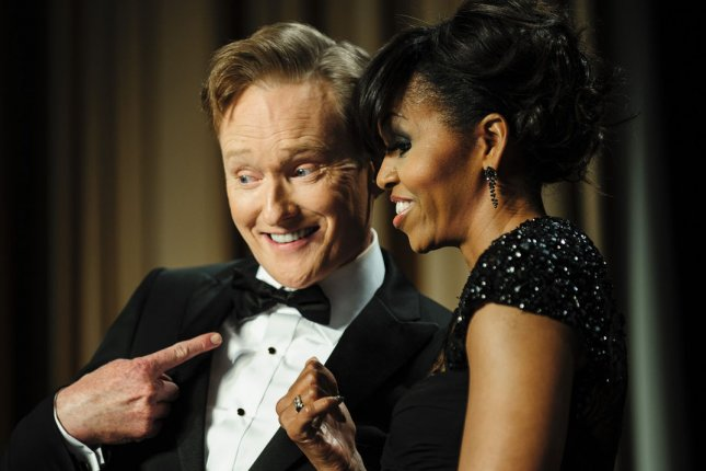Host Comedian Conan O'Brien and First Lady Michelle Obama mug for the cameras during the White House Correspondents' Association (WHCA) Dinner in Washington, D.C. O'brien was recently tapped to host the 2014 MTV Movie Awards. (UPI/Pete Marovich/Pool)