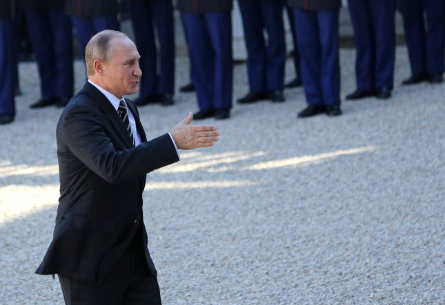 The United States should respond to Russian President Vladimir Putin, shown here last year in France, with non-military tools, not planning for a war. File Photo by David Silpa/UPI