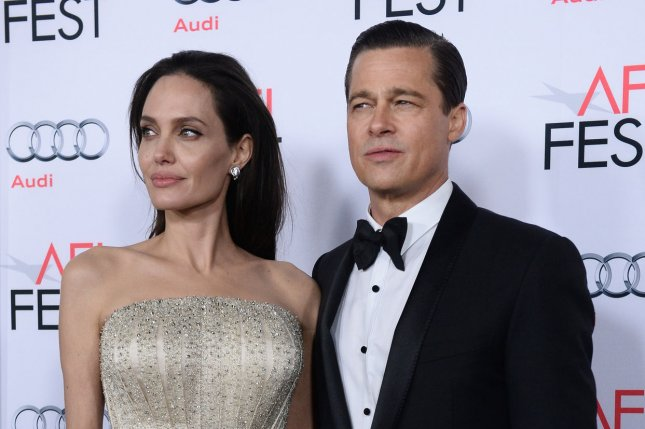 Cast member Angelina Jolie, who wrote and directed the motion picture romantic drama By the Sea, and her husband and cast member Brad Pitt, arrive for the premiere of the film on opening night of the AFI Fest 2015 film festival in Los Angeles on November 5, 2015. File Photo by Jim Ruymen/UPI
