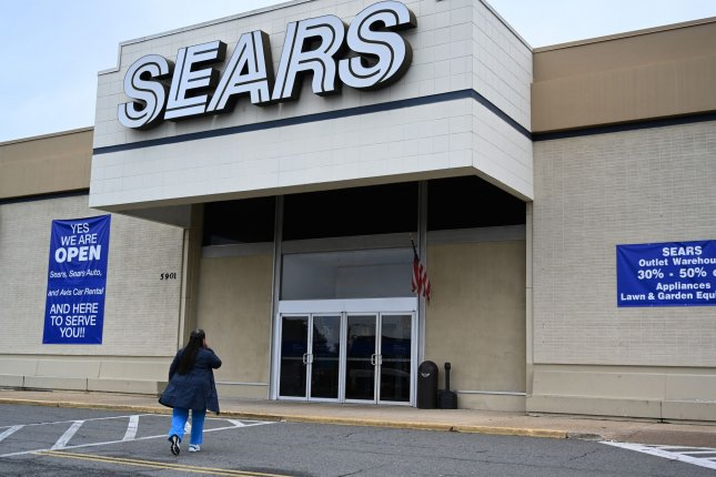 A woman enters a Sears store in Alexandria, Va. as the iconic American retailer Sears filed for Chapter 11 bankruptcy on Monday. Photo by Pat Benic/UPI
