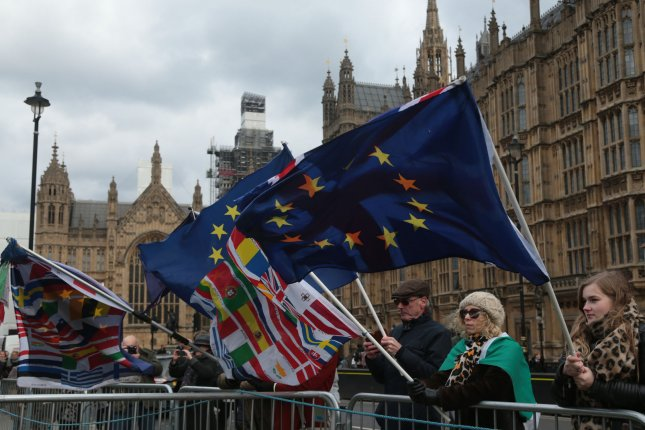 Brexit protesters hold EU flags outside the Houses of Parliament in London on December 12. Photo by Hugo Philpott/UPI