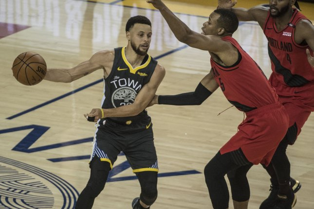 Golden State Warriors guard Stephen Curry (L) is averaging 27.3 points, 6.3 rebounds and 5.6 assists in the postseason. The Warriors hold a 31-1 record when Curry plays and Kevin Durant is out. Photo by Terry Schmitt/UPI