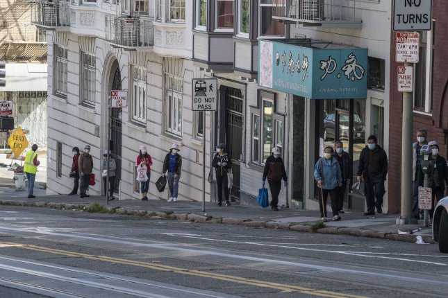 People line up on Powell Street to received food from the San Francisco-Marin Food Bank in San Francisco on May 7. Photo by Terry Schmitt/UPI