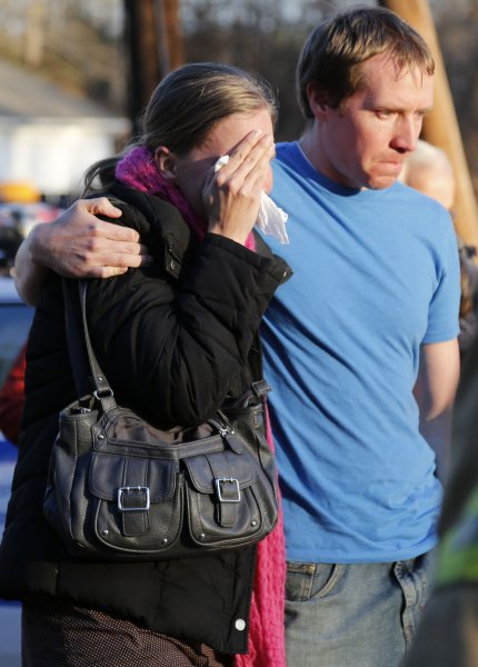 Parents are seen at Sandy Hook Elementary School in Newtown, Conn., on December 14, 2012, following a shooting attack that killed 26 people, mostly young children. File Photo by John Angelillo/UPI