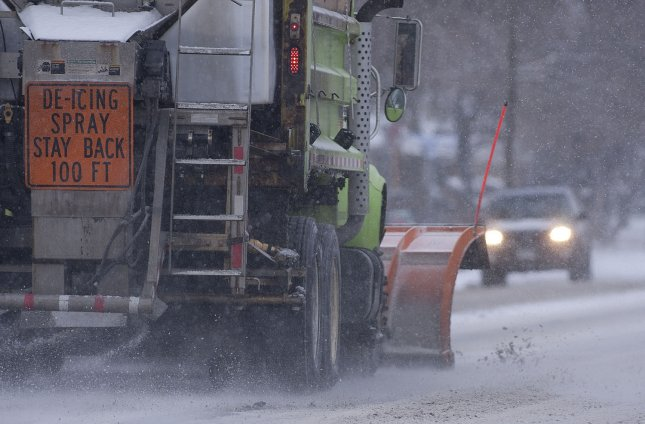 Snow removal vehicles take to the streets as the work day ends during a snowstorm in Denver on January 31, 2011. UPI File Photo/Gary C. Caskey