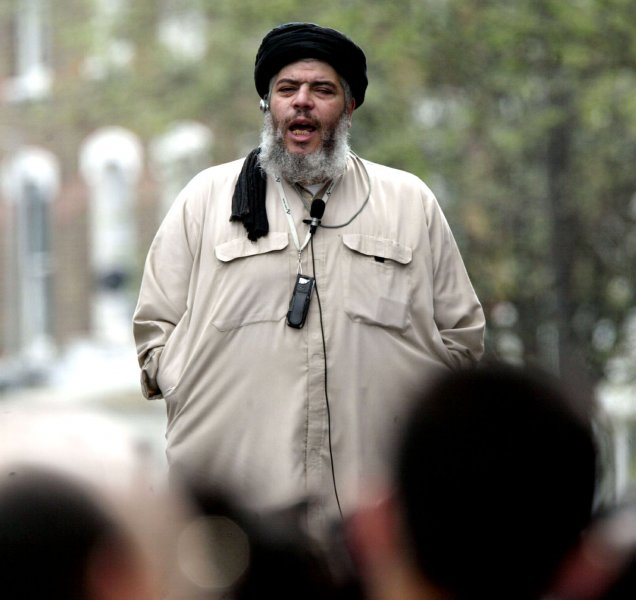 Radical Muslim leader Sheikh Abu Hamza delivers his Islamic message at traditional Friday prayers on the street outside London's Finsbury Mosque on April 16, 2004. Abu Hamza is fighting to remain in the country after having his citizenship revoked by Britain's Home Secretary last year on the grounds of incitig racial hatred. (UPI Photo/Hugo Philpott)