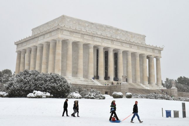 People walk by the Abraham Lincoln Memorial in Washington, D.C., on Monday, President's Day 2016. The National Park Service announced Monday an $18.5 million donation from American businessman and philanthropist David Rubenstein, of The Carlyle Group, which will repair and restore the memorial over the next four years. Photo by Kevin Dietsch/UPI