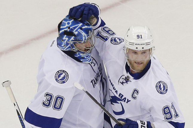 Tampa Bay Lightning's Ben Bishop celebrates with Steven Stamkos. Photo by John Angelillo/UPI