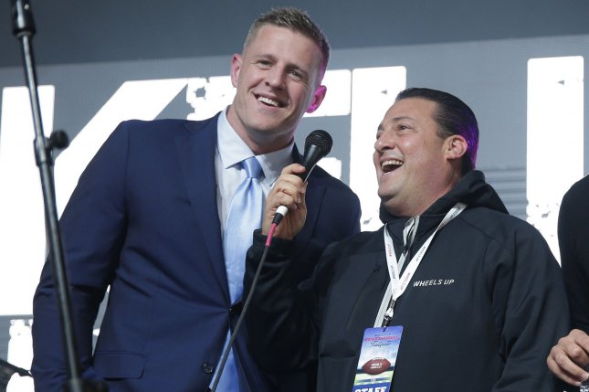J.J. Watt and Wheels Up Founder and CEO Kenny Dichter smile on the stage at the Wheels Up Super Saturday Tailgate event on the eve of Super Bowl LI in Houston, Texas on February 4, 2017. The New England Patriots beat the Atlanta Falcons in Super Bowl LI on Sunday at NRG Stadium. Photo by John Angelillo/UPI