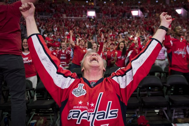 A Washington Capitals fan celebrates as the Capitals win the Stanley Cup during a watch party at the Capital One Arena, in Washington, D.C. Photo by Kevin Dietsch/UPI