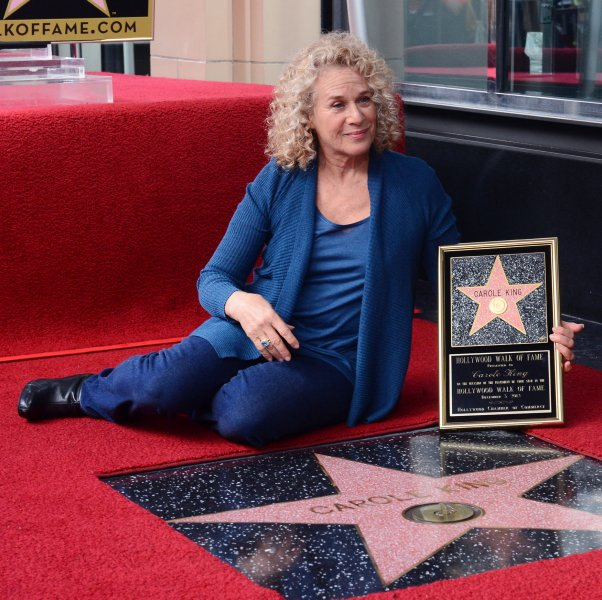 Singer and songwriter Carole King holds a replica plaque during an unveiling ceremony honoring her with the 2,486th star on the Hollywood Walk of Fame in Los Angeles on December 3, 2012. UPI/Jim Ruymen