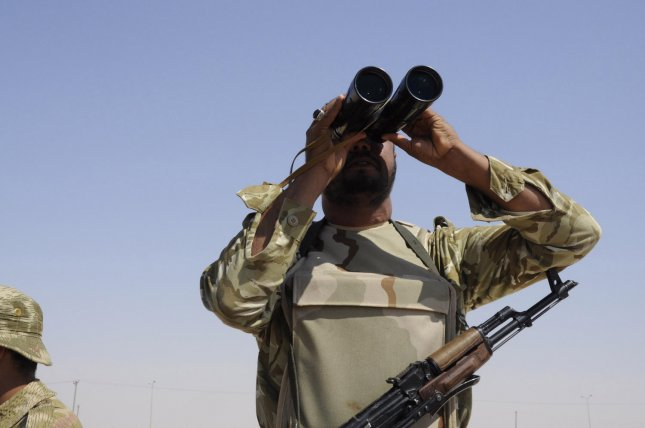 A Libyan Rebel uses field glasses to monitor the area near the Ajdabiya at a check point prior heading towards the front line outside the Libyan eastern city Ajdabiya on May 12, 2011, where fighting between rebels and forces loyal to leader Moamer Kadhafi is ongoing. UPI\Tarek Alhuony.